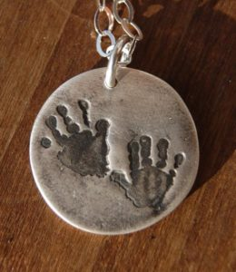Handprint Necklace by Kaleen Wolfe Designs